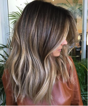 Tone down lightened locks with a dark root and lowlights.